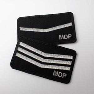 Dystynkcje MDP na mundur bojowy